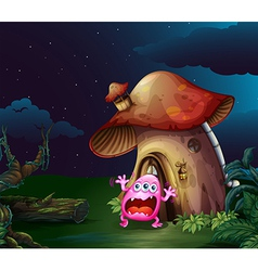 A scared monster near the mushroom house vector