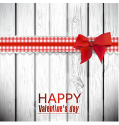 Red cloth ribbon on wooden background Valentines vector image