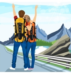 young couple of hitchhikers standing on road vector image