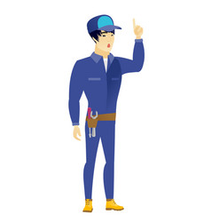 mechanic with open mouth pointing finger up vector image