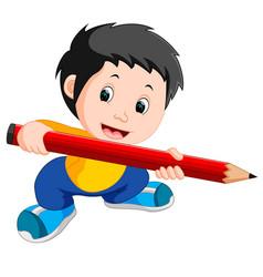 young boy holding a big pencil vector image