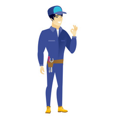 smiling mechanic showing ok sign vector image vector image