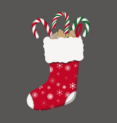 Red christmas stocking with candy canes and vector