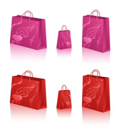 Shopping bags with hearts vector