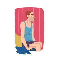 young man sitting on his bed after waking up vector image