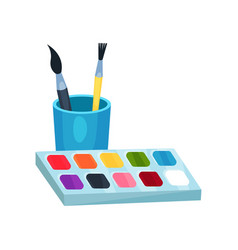Bright watercolor paints in box and brushes in cup vector