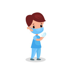 Cute boy doctor in professional clothing in vector