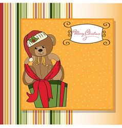 Cute teddy bear with a big Christmas gift box vector
