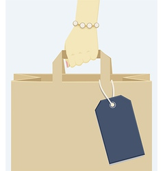 Female hand carrying a shopping paper bag vector