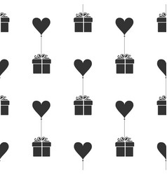 Gift with balloon in shape of heart icon vector