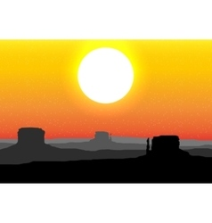 Monument Valley Arizona against a red sunset sky vector image