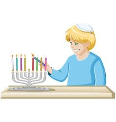 Boy Lights A Hanukkiah Candle vector image vector image
