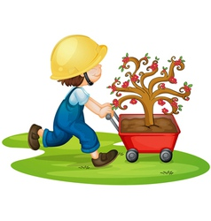 a boy carrying tree vector image
