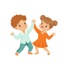 Cute little boy and girl dancing holding hands vector