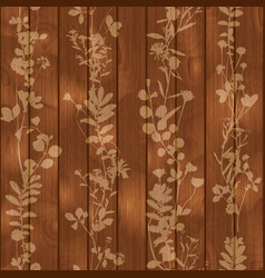 silhouette leaves flowers on wooden background vector image