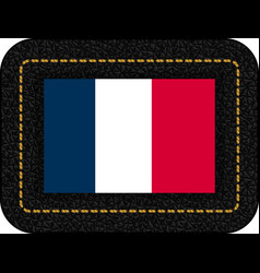 flag of france icon on black leather backdrop vector image