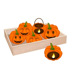 A Pile of Jack-o-Lantern Pumpkins in Wooden Box vector image vector image