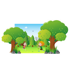 Park scene with two kids catching butterfly vector