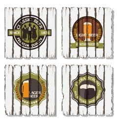 Beer badges and labels on wooden background vector image