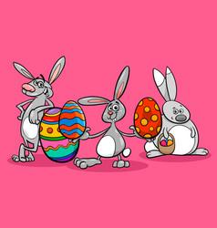 bunnies and easter eggs cartoon vector image