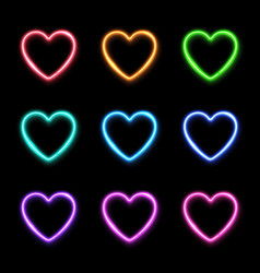 neon light hearts set on dark background vector image