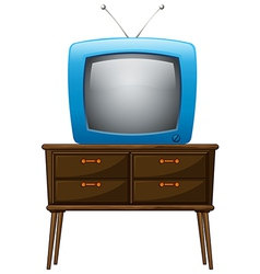 A television above wooden table vector
