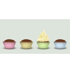 Four cupcakes in multi-colored pieces of paper vector image vector image