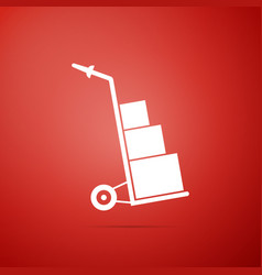 hand truck and boxes icon on red background vector image