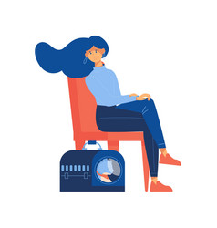 woman sitting on chair with cat in pet carrier vector image