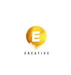 E gold letter logo design with round circular vector