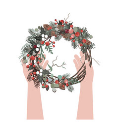Top view of hands holding a christmas wreath xmas vector