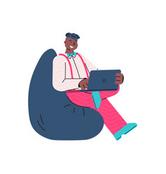 Cartoon man with laptop sitting on bean bag chair vector