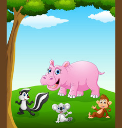 happy animals cartoon on the field vector image