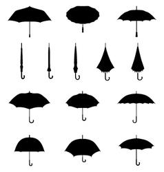 silhouettes of umbrellas vector image