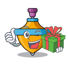With gift spinning top mascot cartoon vector