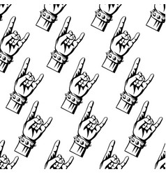 Rock and roll or heavy metal hand sign pattern vector