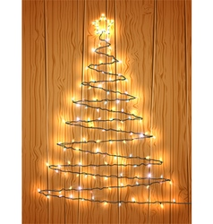 Christmas tree with light on wooden background vector image vector image