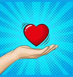 Hand ist holding a big red heart vector