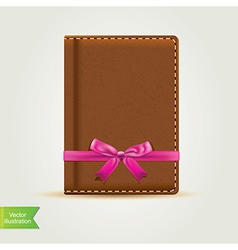 Book with pink bow vector image