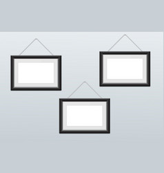 white picture frames hanging on the wall vector image vector image