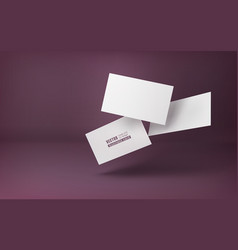 three white business cards on a burgundy vector image