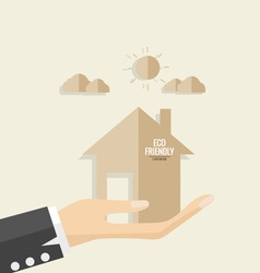 Ecology concept paper cut of house on hand vector