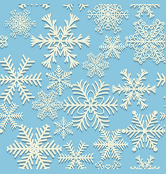 Seamless winter pattern white snowflakes on blue vector