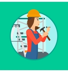 Worker hammering nail vector