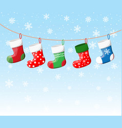 Christmas stockings in various colors on rope vector