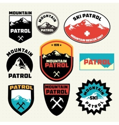 Set ski patrol mountain badges and logo patches vector