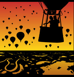 Lovers in balloon at sunset vector