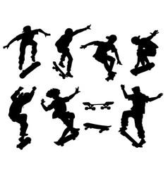 Skateboarders perform tricks black silhouette vector