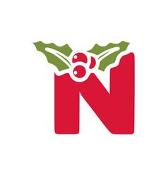 Red letter n with mistletoe christmas lettering vector
