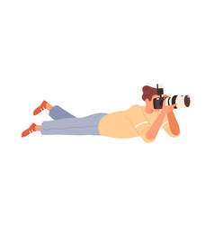 male photographer lying down and shooting with vector image